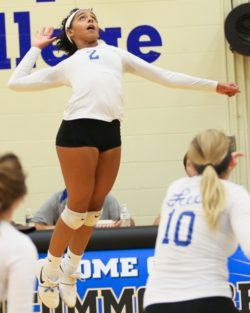 Kelli Warren Jumping to hit the volleyball