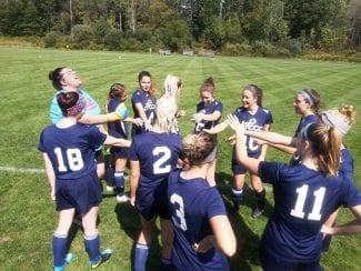 Women's Soccer Team huddle