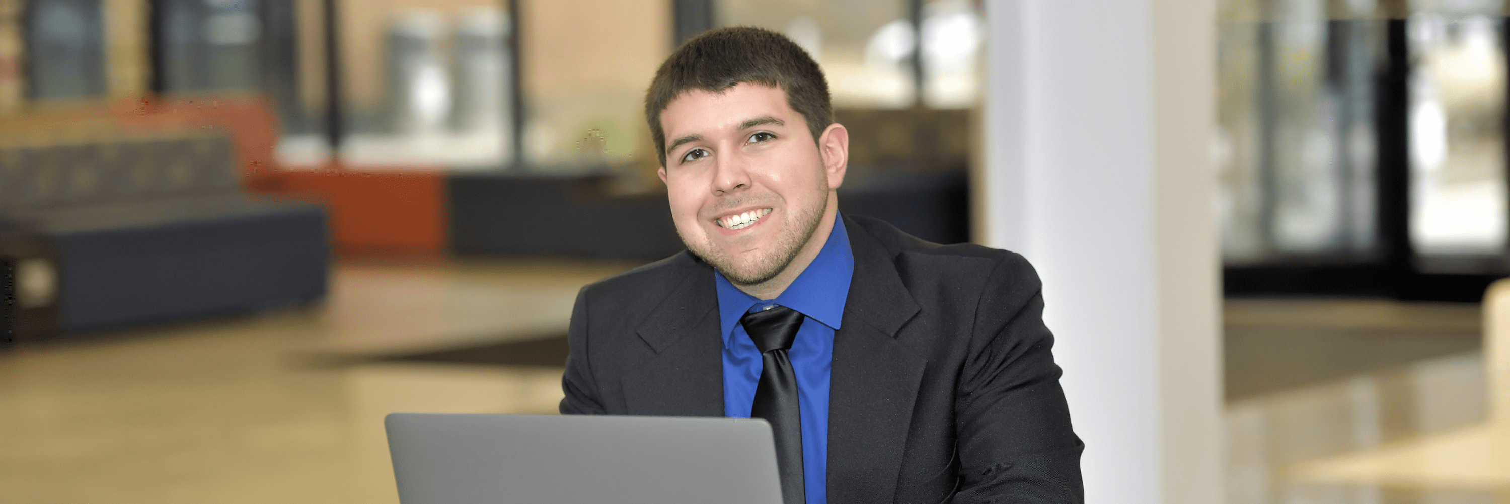 Young professional male at laptop