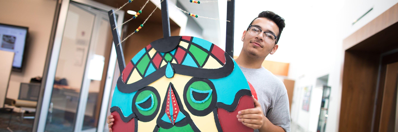 STEAM Camp student holding artwork
