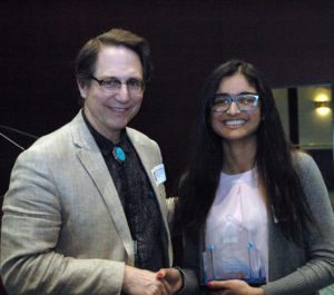 Arisha Anand receiving her award from Dr. Johnathan Dryden