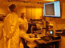 A group of students and an instructor working in a cleanroom