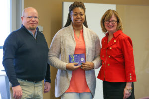 Jamesha Amerson (center) - Pictured with John Myers and Dr. Ballinger