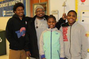 Quint Thomas poses with his three children