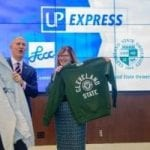 LCCC President Marcia Ballinger and CSU President Harlan Sands holding sweatshirts from LCCC and CSU