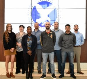 LCCC student veterans and their advisors stand during the induction ceremony.