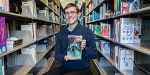 Author Zackery McConnon holds his first novel