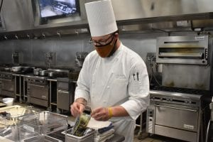 Chef Mark Wagner in white coat and chef hat