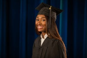 Anaiya Little in black graduation cap and gown