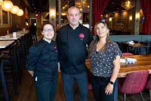 Chef Adam Schmith, center, with Marisa Goodman, left, and Jessica Key