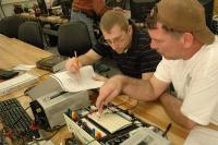 Students with Electronic Equipment