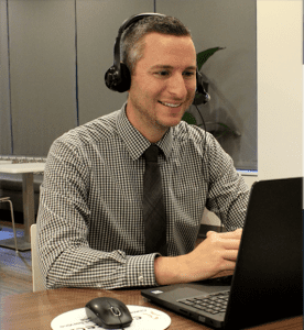 Man with headset at laptop