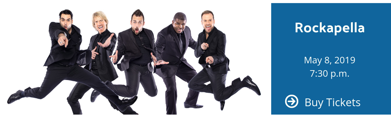 Rockapella - Men in suits jumping and smiling