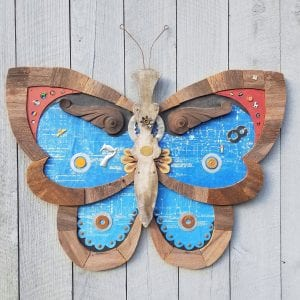 An art project made with found objects in the shape of a beautiful blue butterfly