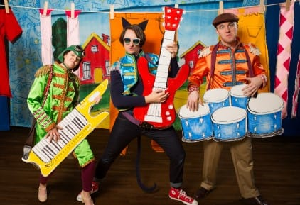 Pete the Cat Cast dressed in colorful clothes and playing musical instruments