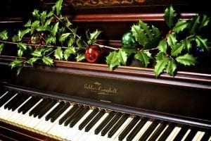 Piano decorated with holly