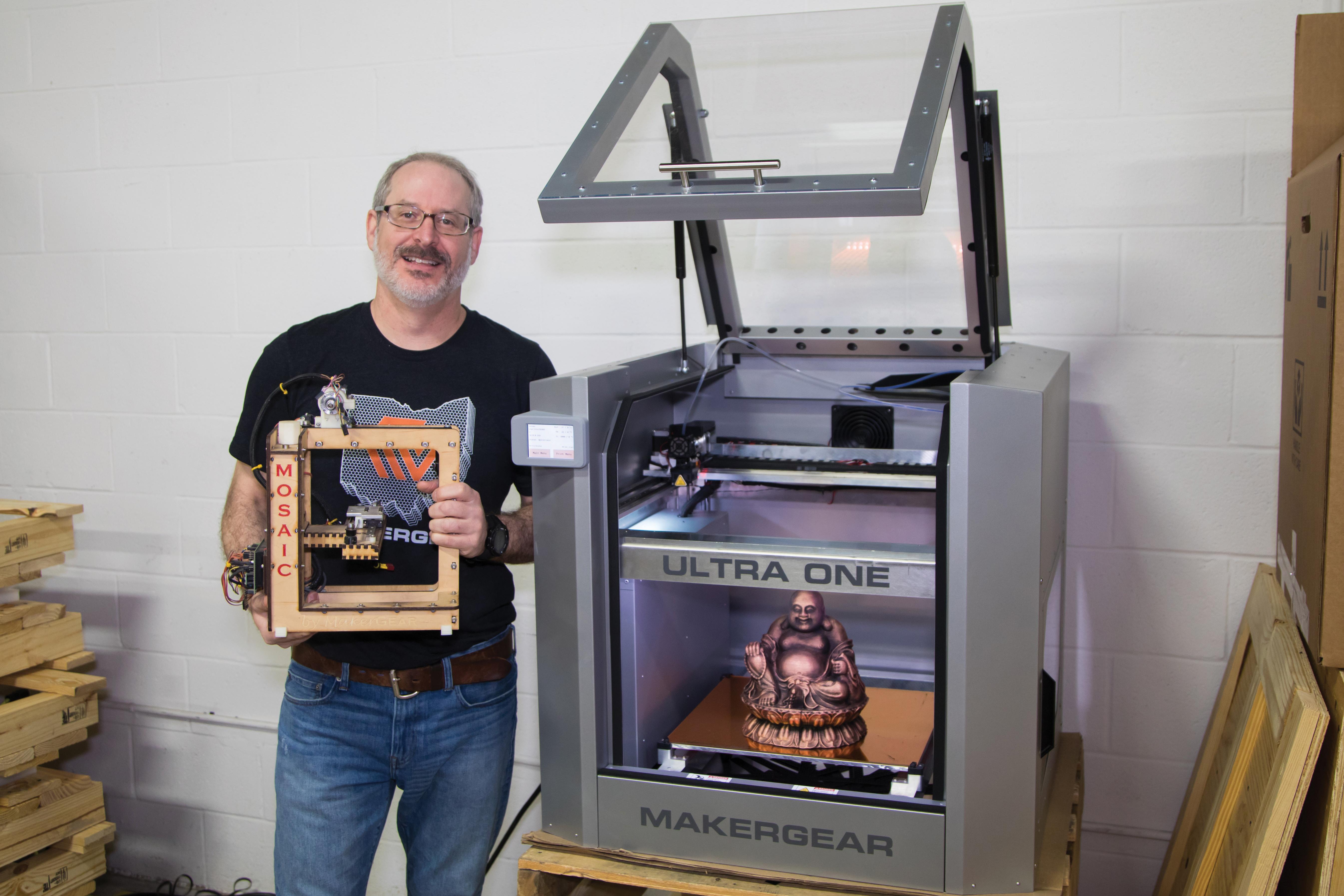 Man holding mechanical equipment