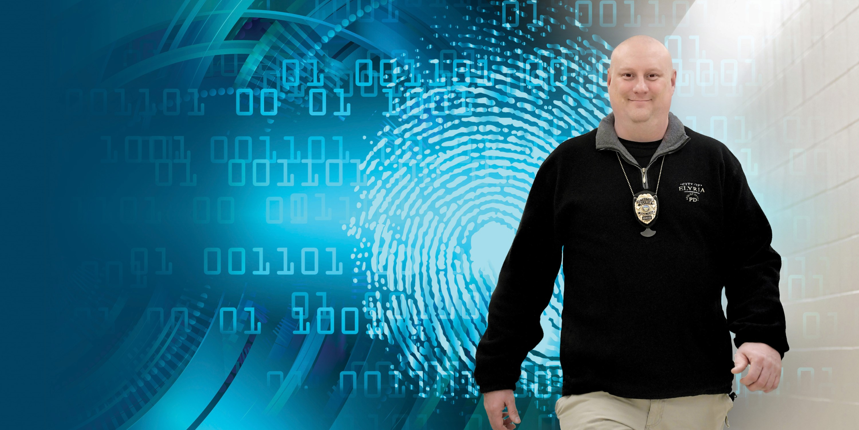 Dan Sumpter standing in front of a graphic image with technology and a fingerprint.