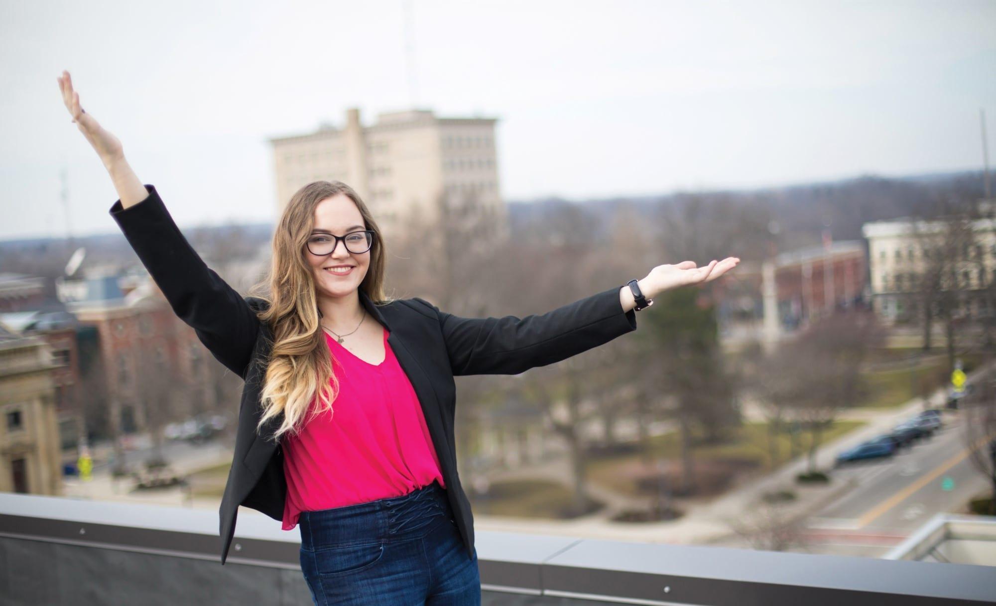 Alex Moen on top of building overlooking city