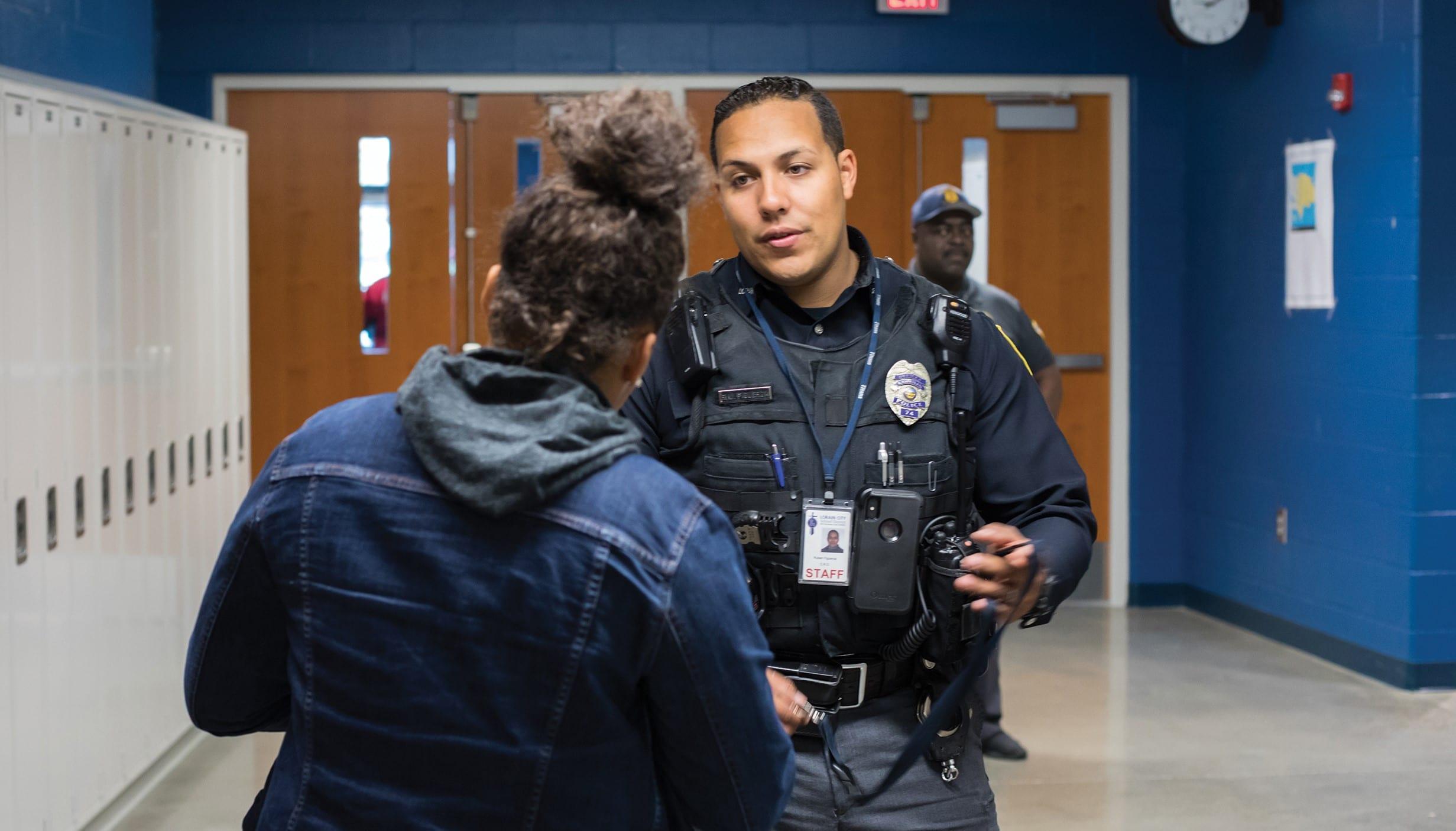 Reuben Figueroa talking to a student
