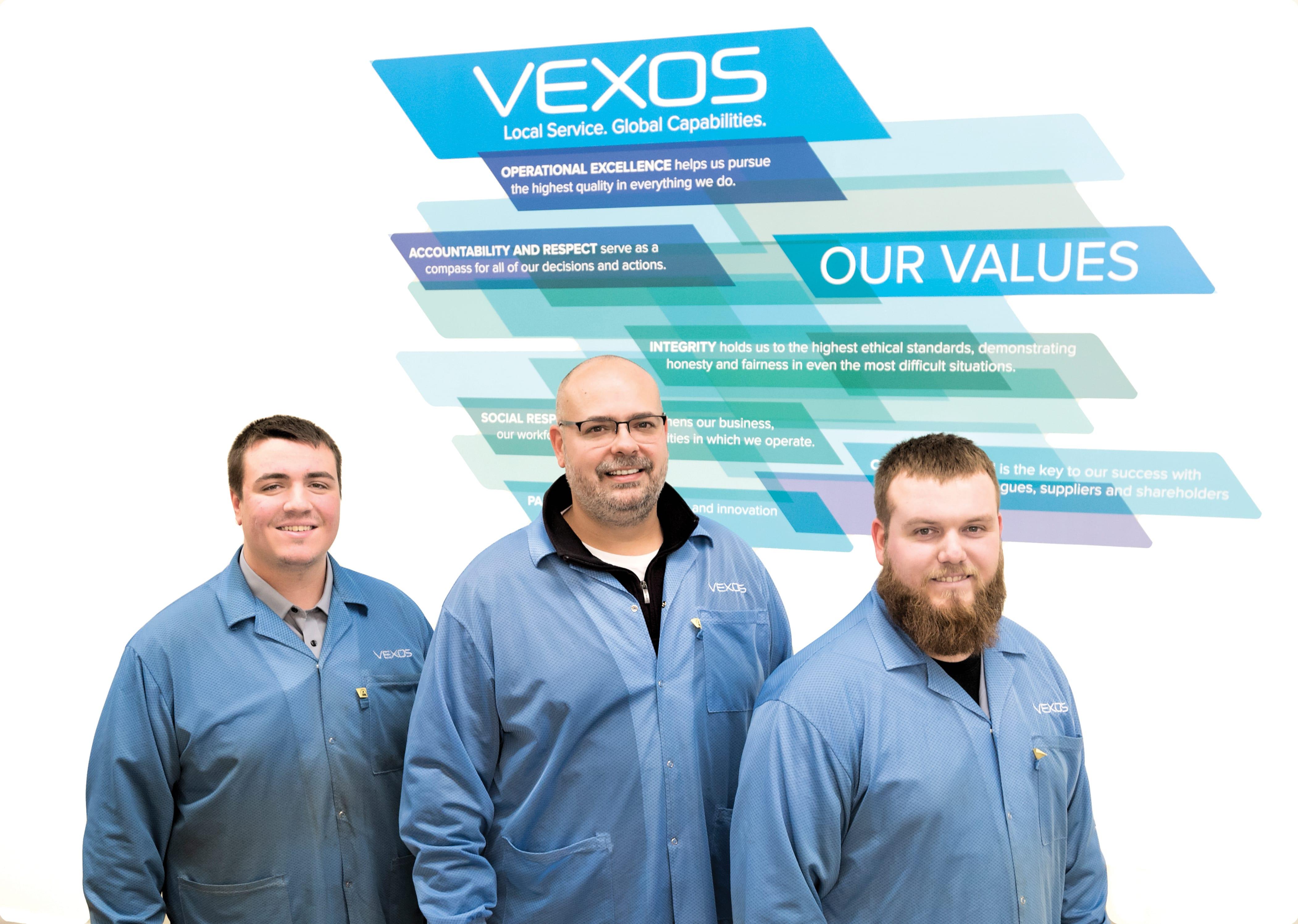 Trevor Zitek with coworkers at Vexos