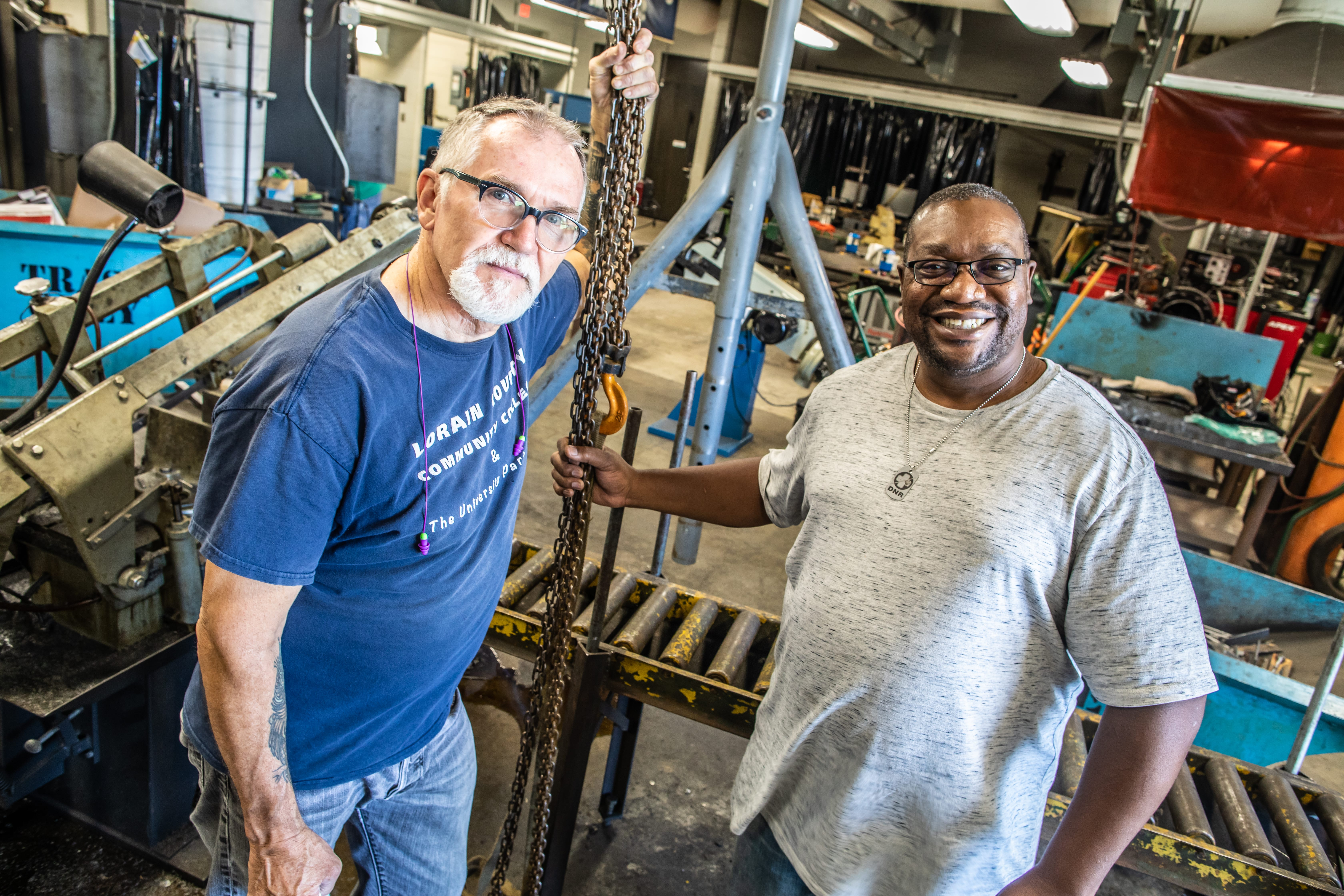 LCCC welding instructor Larry Waller and Erick Belmer
