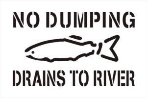 A No Dumping Drains to River sign for storm drains